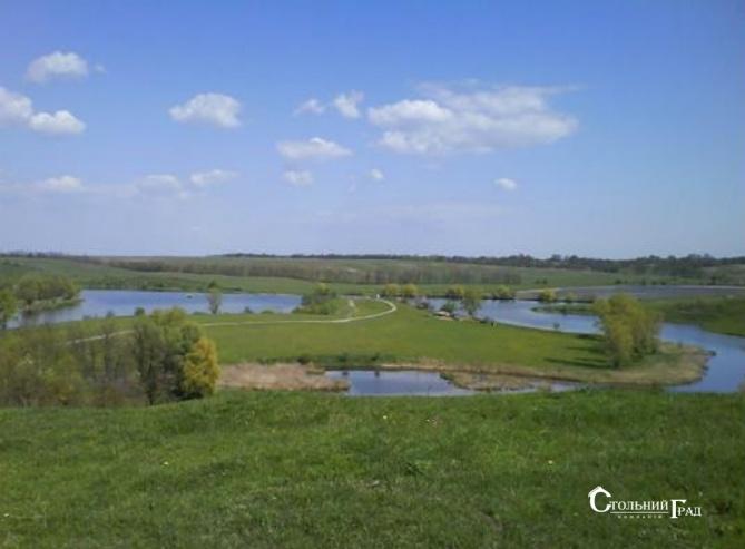 Продам мальовничу ділянку в Обухівському районі на березі озера - АН Стольний Град фото 1